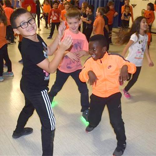 Grade 3 students Isaiah Alas-DaSilva, Oliver Milanko and Jaden Molefhi, left to right, display their dance moves. Photo by Laura Lennie, Metroland